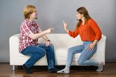 Man And Woman Having Horrible Fight While Sitting On Sofa. Friendship, Couple Breakup Difficulties A poster