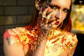 Halloween Beauty Witch Girl Portrait With Golden Make-up. Glitter Metallic Shine Golden Make-up. Bur poster
