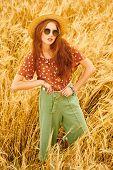 Beauty, fashion shoot. Portrait of a modern hippie girl in a wheat field. Bohemian style. poster