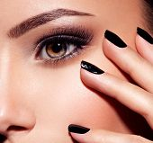 womans eye with pink eye makeup. Macro style image poster