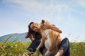 Woman Hugging Scotch Collie Dog In Meadow. Woman Hugging Scotch Collie Dog In Nature. Close Up Of Sc poster