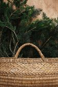 Rustic Basket With Fir Branches On Rustic Wooden Background. Flat Lay. Winter Holiday Preparations. poster