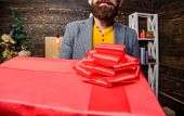 Courier Giving Gift. This Is For You. Man Santa Deliver Gift. Bearded Guy Carry Present Box Close Up poster