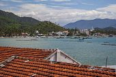 Nha Trang District On The Way To The White Sand Doc Let Beach , Red Tile Roofs On A Background Of Th poster