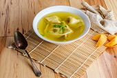 Authentic Chinese Food Wonton Soup Garnished With Sliced Green Onion poster