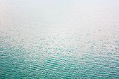 Texture Of Transparent Clear Surface Of Turquoise Azure Water With Small Ripples Fish And Sun Reflec poster