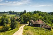 Village In Countryside Landscape. Fields And Countryside Landscape. Old Village In Nature In Summer. poster