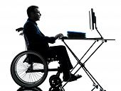 pic of handicapped  - one handicapped business man computing laptop computer in silhouette studio  on white background - JPG