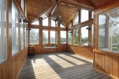 foto of screen-porch  - Large wooden porch with lake view in luxury home - JPG