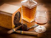 pipe tobacco cuban cigar and liquor