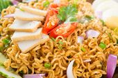 Close up Dry Instant Noodle, Malaysian style maggi goreng mamak or spicy dry curry instant noodles.