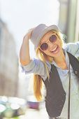 foto of stroll  - Portrait of happy young hipster in the city - JPG