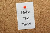 image of time-piece  - The phrase Make The Time typed on a piece of paper and pinned to a cork notice board - JPG
