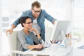 stock photo of team  - Young design team working at desk in creative office - JPG