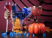 foto of happy halloween  - Happy Halloween ghoulish party cocktail drinks with spider web and decorations on purple background - JPG