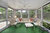 image of screen-porch  - Porch in suburban home with green flooring - JPG