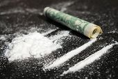 stock photo of hallucinations  - Lines of cocaine and one dollar bill - JPG