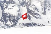 image of engadine  - The Switzerland flag over the Diavolezza Mountain