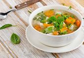 image of vegetable soup  - Soup with chicken and vegetables on wooden table  - JPG