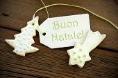 stock photo of natal  - The Italian Words Buon Natale which means Merry Christmas on a Label with Christmas Cookies  - JPG