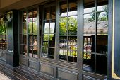 pic of posh  - Glazed entrance to the luxurious restaurant with an opened window - JPG