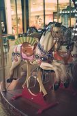 picture of merry-go-round  - Carousel horse on a carnival merry - JPG