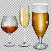 image of champagne glass  - Three transparent glass goblets with cognac champagne and beer - JPG