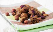 stock photo of baked raisin cookies  - Italian cookies Florentino with raisins and walnuts on wooden background - JPG