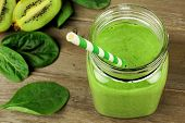 picture of fruit-juice  - Healthy green smoothie with spinach and kiwi in a jar mug on wood downward view - JPG