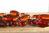 picture of prophylactic  - dietary supplement pills on wooden desk, photo ** Note: Shallow depth of field - JPG