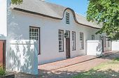 stock photo of south-western  - Historical building in Stellenbosch in the Western Cape Province of South Africa - JPG
