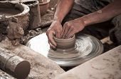 foto of loam  - Image of Artisan hands making clay pot - JPG