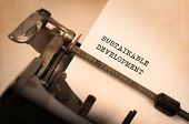 stock photo of sustainable development  - Vintage inscription made by old typewriter sustainable development - JPG