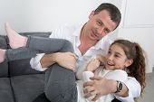 stock photo of daddy  - A Pretty little girl with her daddy - JPG