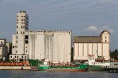 image of silo  - Silos and a ship in a port - JPG
