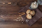 stock photo of baked raisin cookies  - oatmeal cookies and jar with cookies close - JPG