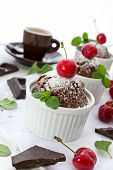 stock photo of chocolate muffin  - Chocolate muffins with cherry and chocolate pieces - JPG
