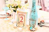 image of wedding table decor  - Table with beautiful decorations for a wedding - JPG