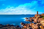 image of granite  - Ploumanach Mean Ruz lighthouse red sunset in pink granite coast Perros Guirec Brittany France - JPG