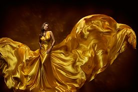stock photo of flutter  - Fashion Model Woman Dress Lady In Fluttering Silk Beauty Gown Fabric Waving On Wind Beautiful Girl With Long Dynamic Flying Cloth - JPG