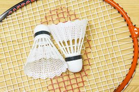 stock photo of game-cock  - equipment badminton Shutter Cock on a brown background, ** Note: Soft Focus at 100%, best at smaller sizes - JPG