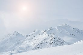 picture of winter sport  - Winter snow covered mountains on a cloudy day - JPG