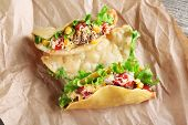 image of tacos  - Tasty taco with vegetables on paper close up - JPG