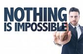 foto of impossible  - Business man pointing the text - JPG