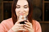 picture of wine cellar  - Young woman tasting wine in cellar - JPG