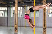 foto of pole dancer  - Woman dancing on the pole at the gym - JPG