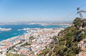 pic of gibraltar  - View of the city of Gibraltar and cable car close to the top of Gibraltar rock - JPG