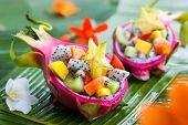 image of dragon fruit  - Exotic fruit salad served in half a dragon fruit - JPG