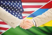 picture of mauritius  - Businessmen shaking hands  - JPG