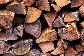 picture of firewood  - Firewood stacked together pile of heating during cold weather - JPG